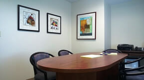 conference room table chairs and paintings