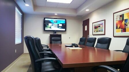 video conferencing center with table and chairs